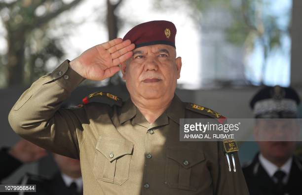 Major General Jalil alRubaie commander of Baghdad operations in the Iraqi army salutes the forces during a parade in Baghdad marking Police Day on...