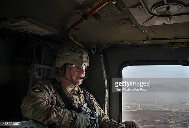 Major General James C McConville flies out for a meeting to Camp Clark in Khost Province Afghanistan on Saturday December 14 2013