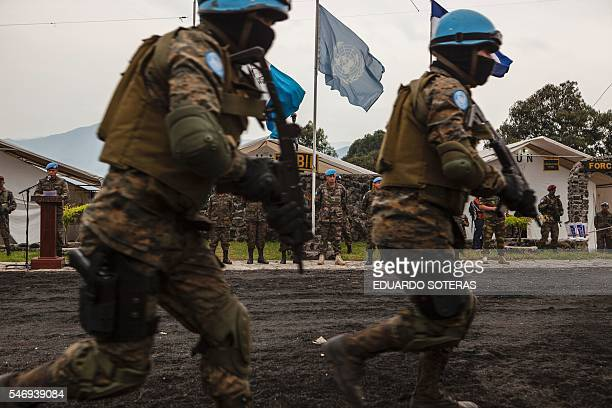 Major General Jean Baillaud deputy head of the UN Mission in the Democratic Republic of Congo visits the Guatemalan military base in Sake on July 12...