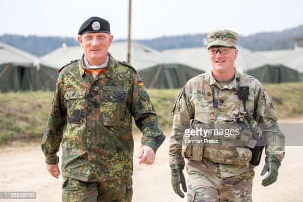 Major General JuergenJoachim von Sandrart of the German Bundeswehr and Colonel Joe Hilbert of the US Army arrive for a press briefing during the...