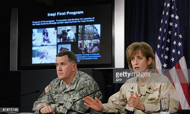 US Major General Kevin J Bergner spokesman for MultiNational ForcesIraq and Rear Admiral Kathleen M Dussault commander of the Joint Contracting...