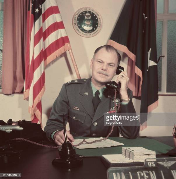 Major General Leon W Johnson of the United States Air Force seated at a desk in his office at RAF South Ruislip Air Force station near London in...