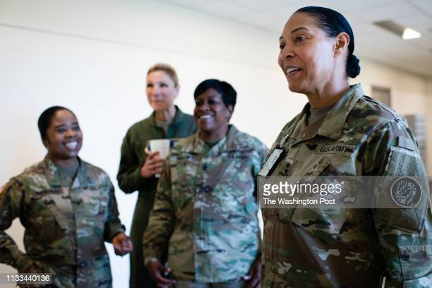 Major General Linda L Singh right Adjutant General of Maryland is pictured in the pentagon after the press conference Others from left to right are...