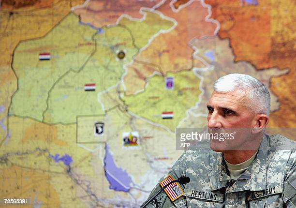 Major General Mark P Hertling commander of the MultiNational Division North listens to a question during a joint press conference with US Major...