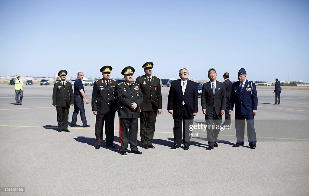 Major General Najafov, head of the international cooperation department at Azerbajan's Ministry of Defense, General-Colonel Safar Abiyev, Azerbajan's Minister of Defense standing with hands folded front, Yashar Aliyev, Azerbaijani ambassador to the United States, Donald Lu, charge d'affaires of the United States Embassy in Baku, Azerbajan, and Col. Doug Sachs, USAF, U.S. Defense Attache, wait on the tarmac to greet Secretary Robert M. Gates at the Heydar Aliyev International Airport June 6, 2010 in Baku, Azerbaijan. On the table in front of Aliyev is a letter from President Barack Obama. Gates left Singapore earlier today after participating in the Shangri-La Dialogue's Asia Security Summit, which ran from June 4 to 6, 2010.