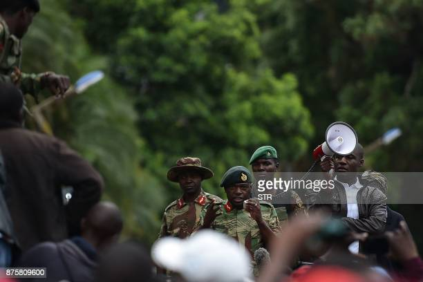 Major General Sibusiso Moyo addresses protestors who gathered for a march to demand to the 93 yearold Zimbabwe's president to step down after...