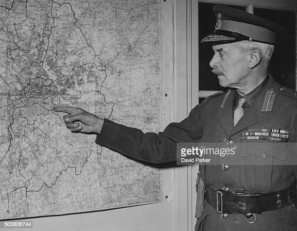 Major General Sir Cecil Pereira the new London area organizer for the Local Defense Volunteers during World War Two pointing at a wall map May 24th...