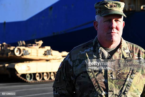 Major General Timothy McGuire Deputy Commander of US miltary in Europe pursues the unloading of US Military vehicles from a transport ship in the...