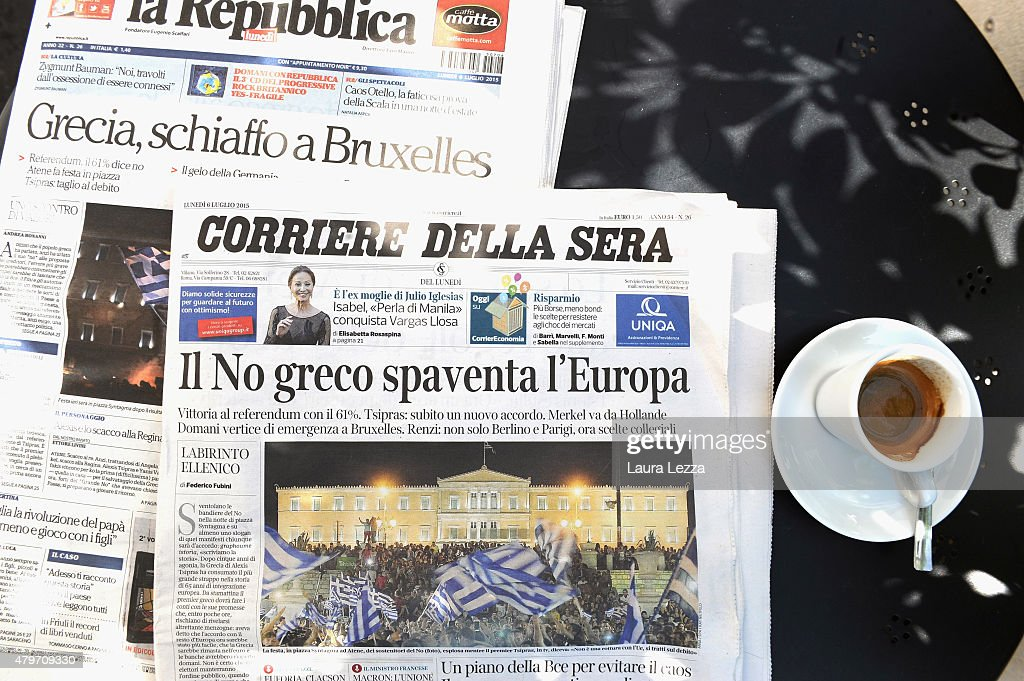 Major Italian newspapers are seen on a table outside a cafe the day after Greece's austerity referendum which dominates the Italian front pages today, on July 6, 2015 in Livorno, Italy. Greeks voted in a strong majority against the reform plan proposed by the Troika, with Italian newspapers highlighting Prime Minsiter Alexis Tsipras's clear victory with the 'No' campaign.