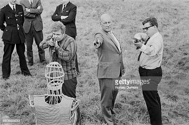 Major J WilkinsonLatham tests out a bulletproof vest to be worn by policemen in the wake of the Shepherd's Bush murders London 23rd August 1966
