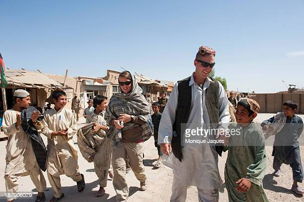 Major Jason Brezler surrounded by local children on the market street on May 13 outside of Nowzad in Helmand Province In attendance were village...