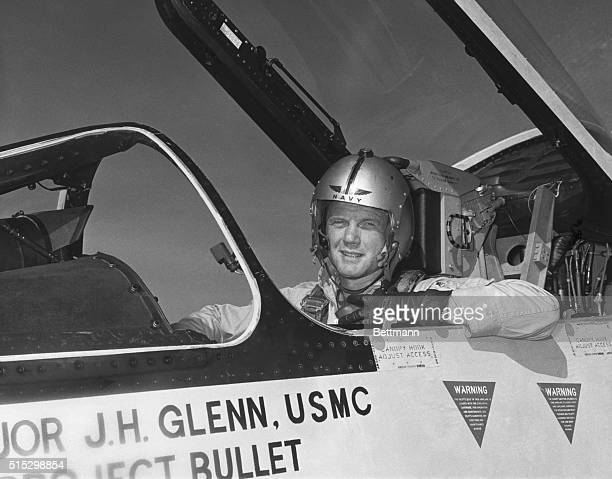 Major John Glenn of the USMC poses in the cockpit of an F8 Fighter