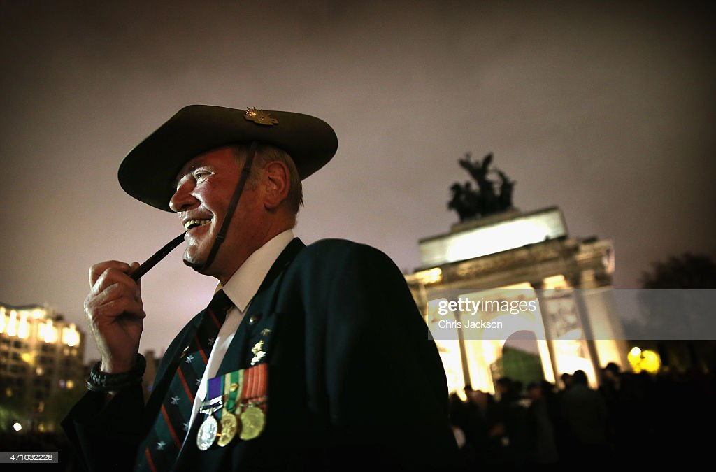 Major John Titley of 3 Royal Australian Regiment smokes his pipe as he waits for the early morning ANZAC Day Dawn Service to start at Wellington Arch on April 25, 2015 in London, England. Today marks the 100th anniversary since the ANZAC landings at Gallipoli, there will be three commemorative ceremonies in London, a Dawn Service, a wreath laying ceremony at The Cenotaph and a service at Westminster Abbey. The Gallipoli land campaign, in which a combined Allied force of British, French, Australian, New Zealand and Indian troops sought to occupy the Gallipoli Peninsula and the strategic Dardanelles Strait during World War I, began on April 25, 1915 against Turkish forces of the Ottoman Empire. The Allies, unable to advance more than a few kilometers, withdrew after eight months. The campaign cost the Allies approximately 50,000 killed and up to 200,000 wounded, the Ottomans approximately 85,000 killed and 160,000 wounded.