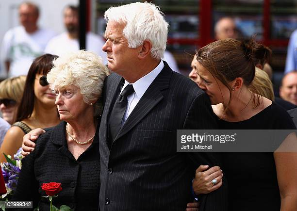 Major Josh Bowmans' family, mother Barbara and father Jonathan Bowman along with sister Louisa, wait for his coffin to be brought through the town on...