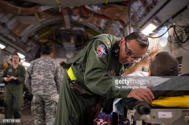 Major Juan Sanchez a nurse tends to a patients on a recent flight aboard a C17 transporting injured Armed Service members home on one leg of their...