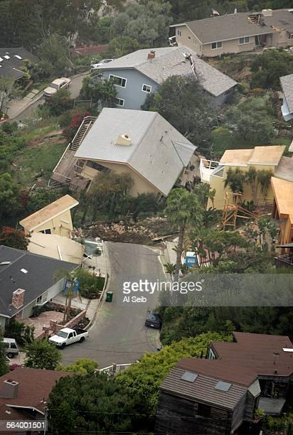 BEACH CA Major landslide in Laguna Beach as several homes slid down a hill in a major landslide in Laguna Beach today but there were no immediate...