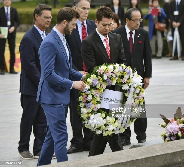Major League Baseball AllStar players Mitch Haniger and Kenta Maeda lay a wreath of flowers at the cenotaph for the atomic bombing victims at...