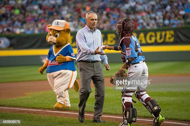 Major League Baseball Chief Operating Officer CommissionerElect Rob Manfred throws out the ceremonial first pitch during the 2014 Little League World...