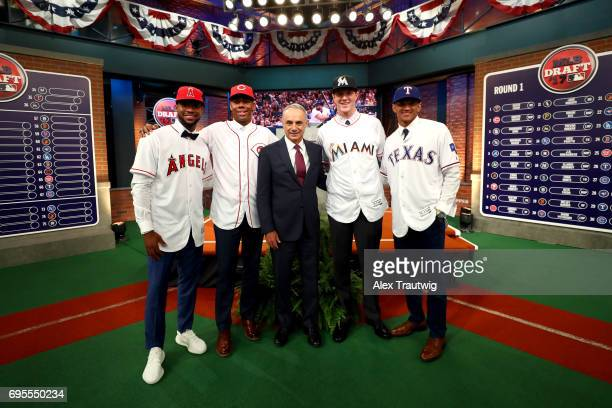 Major League Baseball Commissioner Robert D Manfred Jr poses for a photo with first round picks Hunter Greene Jordon Adell Trevor Rogers and Bubba...