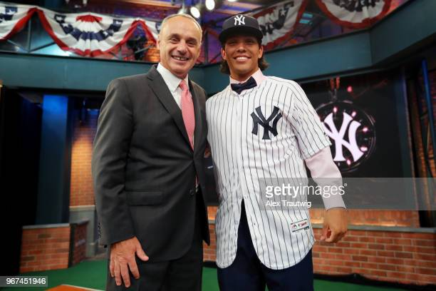 Major League Baseball Commissioner Robert D Manfred Jr poses for a photo with 23rd overall pick by the New York Yankees Anthony Seigler during the...
