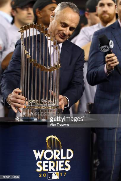 Major League Baseball Commissioner Robert D Manfred Jr presents the Commissioner's Trophy to the Houston Astros owner Jim Crane after the Astros...