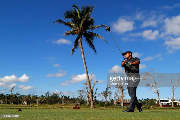 Major League Baseball Hall of Famer Ivan Pudge Rodriguez plays his tee shot on the first hole during the first day of the Puerto Rico Open Charity...