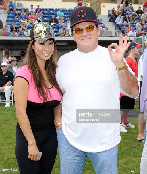Major League Baseball legend Pete Rose and model Kiana Kim pose during Steve Garvey's Celebrity Softball Game for ALS at Pepperdine University on...