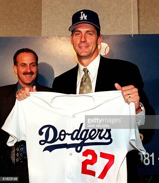 Major league baseball pitcher Kevin Brown holds up his Los Angeles Dodgers jersey after a press conference 15 December where he met with the media...