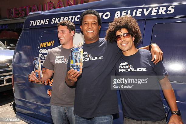 Major League Baseball pitcher Pedro Martinez and contest winners Jason Zone Fisher and Adam Ward promote the Gillette Fusion ProGlide at Planet...
