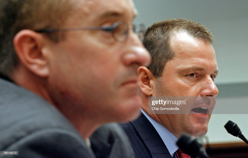 Major League Baseball pitcher Roger Clemens (R) and former Major League Baseball strength and conditioning coach Brian McNamee testify about allegations of steroid use by professional ball players before the U.S. House Oversight and Government Reform Committee on Capitol Hill February 13, 2008 in Washington, DC. The 'Mitchell Report' named several former and current major league baseball players, including Clemens, who are accused of using steroids or other performance-enhancing drugs.
