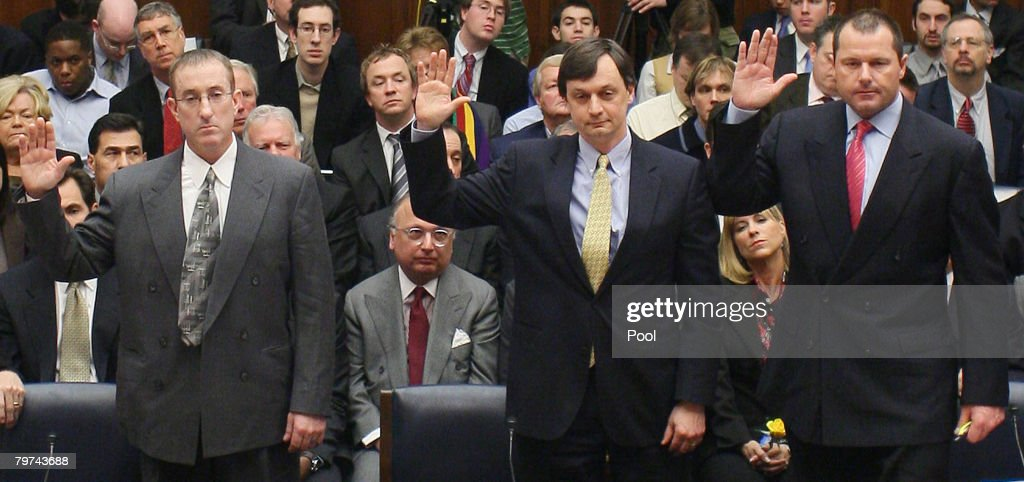 Major League Baseball pitcher Roger Clemens (R), Charlie Scheeler, investigator on former Sen. George Mitchell's staff (C) and and former Major League Baseball strength and conditioning coach Brian McNamee (L) raise their right hands as they are sworn in to testify about allegations of steroid use by professional ball palyers before the U.S. House Oversight and Government Reform Committee on Capitol Hill Feburary 13, 2008 in Washington, DC. The 'Mitchell Report' named several former and current major league baseball players, including Clemens, who are accused of using steriods or other performance-enhancing drugs.