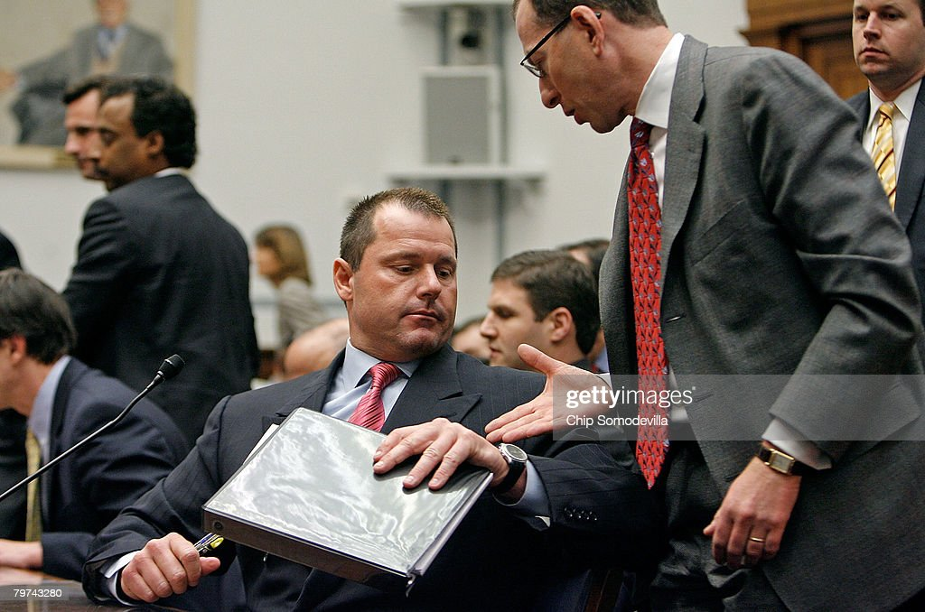 Major League Baseball pitcher Roger Clemens (C) is congratulated by his attorney Lanny Breuer (R) after testifying about allegations of steroid use by professional ball palyers before the U.S. House Oversight and Government Reform Committee on Capitol Hill February 13, 2008 in Washington, DC. The 'Mitchell Report' named several former and current major league baseball players, including Clemens, who are accused of using steroids or other performance-enhancing drugs.