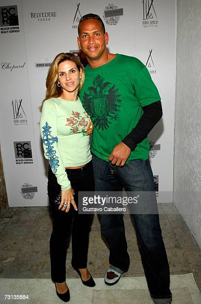 Major League Baseball Player Alex Rodriguez and wife Cinthia Rodriguez poses together at the Nikki Beach 10th anniversary party on January 27 2007 in...