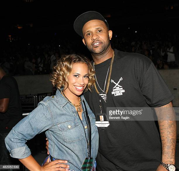 Major League Baseball player CC Sabathia and wife Amber Sabathia attend the D'USSE VIP Riser Lounge At On The Run Tour MetLife Stadium on July 11...