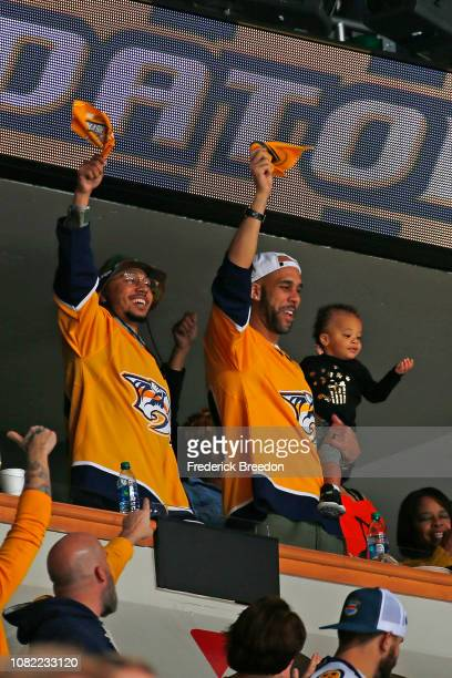 Major League Baseball players David Price and Mookie Betts wave towels to support the Nashville Predators during the first period at Bridgestone...