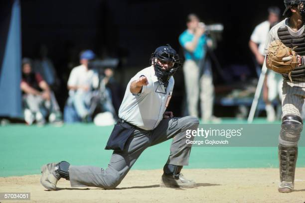 Major League Baseball umpire Doug Harvey signals while calling balls and strikes from behind the plate during a Pittsburgh Pirates game at Three...