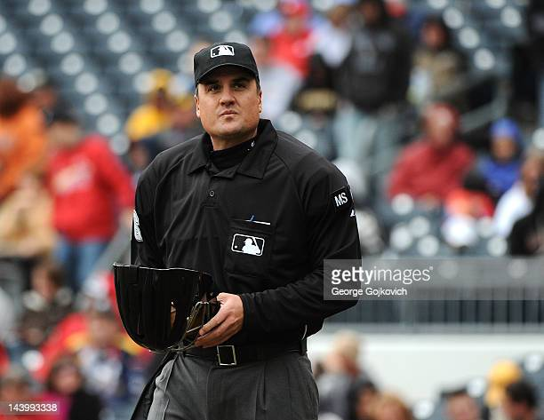 Major League Baseball umpire Mike DiMuro looks on from the field during a game between the St Louis Cardinals and Pittsburgh Pirates at PNC Park on...