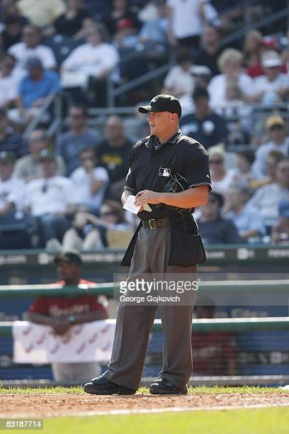 Major League Baseball umpire Scott Barry looks on from near home plate during a game between the Houston Astros and the Pittsburgh Pirates at PNC...