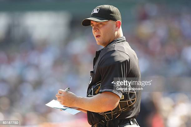 Major League Baseball umpire Scott Barry notes a lineup change during a game between the Houston Astros and the Pittsburgh Pirates at PNC Park on...