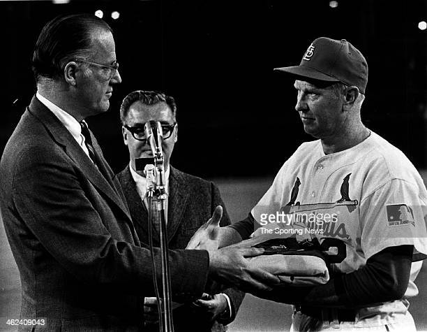 Major League Commissioner Bowie Kuhn presents the 1968 National League pennant to Manager Red Schoendienst of the Cardinals in openingnight...
