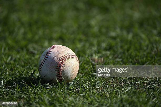 Major League sanctioned baseball sits on the infield grass before play between the San Francisco Giants and the visiting Los Angeles Dodgers at ATT...