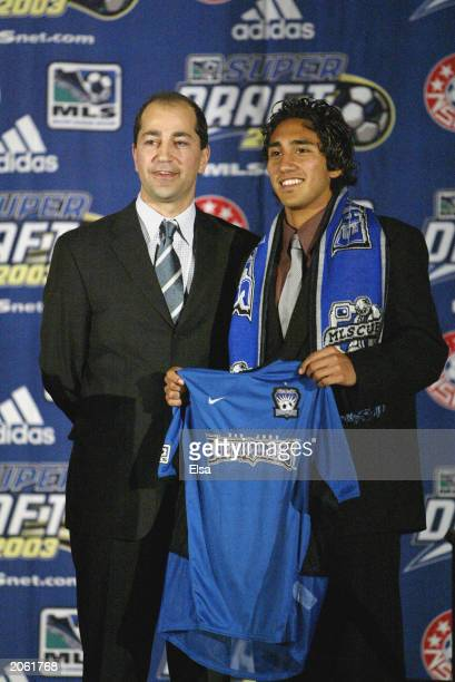 Major League Soccer deputy commissioner Ivan Gazidis poses with the San Jose Earthquakes' second round pick Arturo Alvarez during the MLS Super Draft...