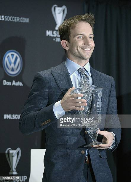 Major League Soccers most valuable player Mike Magee of the Chicago Fire holds the MVP trophy during Thursday's MLS Championship game press...
