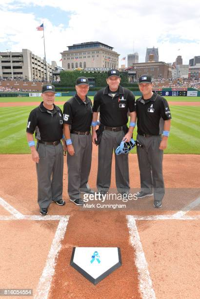 Major League umpires Jerry Meals Ed Hickox Chris Conroy and Ben May pose for a photo prior to the game between the Detroit Tigers and the Tampa Bay...
