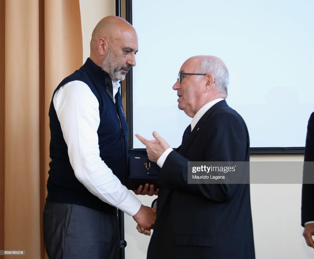 Major of Amatrice Sergio Pirozzi receives the Panchina D'Oro Prize by Carlo Tavecchio president of FIGC during Italian Football Federation 'Panchine D'Oro E D'Argento' Prize at Coverciano on March 27, 2017 in Florence, Italy.