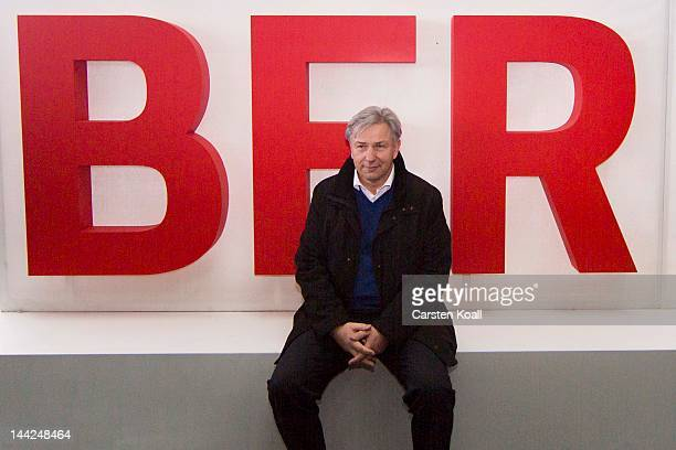 Major of Berlin Klaus Wowereit sits in front of the new sign of the airport at the open house weekend next to the construction site of the main...