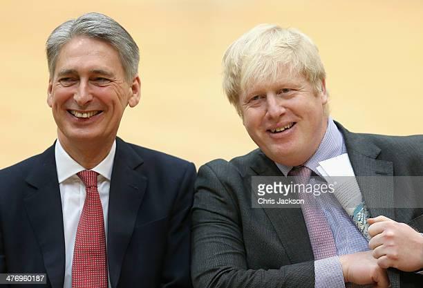 Major of London Boris Johnson and Defence Secretary Philip Hammond share a joke at the media launch for the Invictus Games 2014 at the Copper Box...