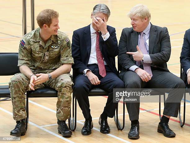 Major of London Boris Johnson and Defence Secretary Philip Hammond share a joke and Prince Harry looks on at the media launch for the Invictus Games...