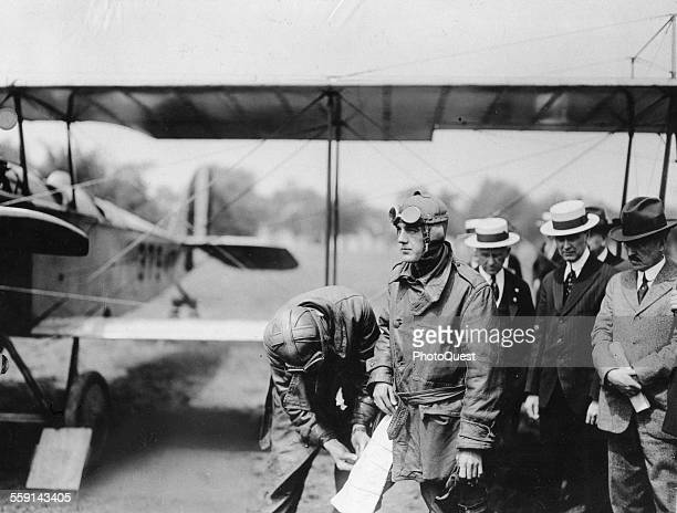 Major RH Fleet attaches an aerial map to the leg of Lt George L Boyle who flew the first mail plane and inaugurated airmail service 1918