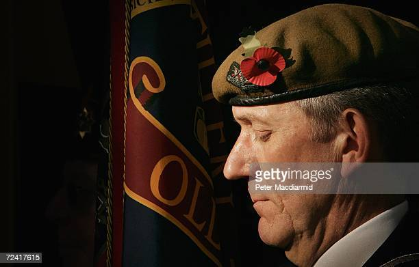 Major Roger Bain stands with the colours of the Honourable Artillery Company during a service of remembrance in the gardens of St Paul's Cathedral on...